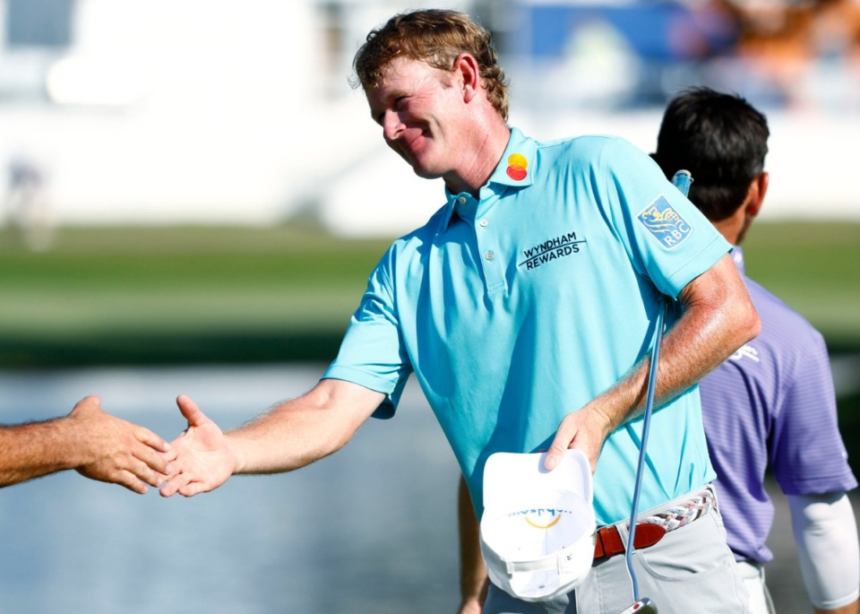 <strong>Brandt Snedeker shakes hands with Louis Oosthuizen as they finish on the 18th green during the second round of the 2019 WGC-FedEx St. Jude Invitational on Friday, July 26, 2019.</strong> (Houston Cofield/Special to The Daily Memphian)