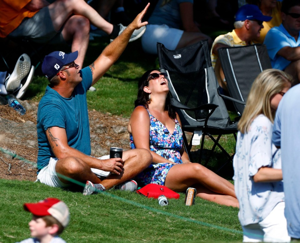 <strong>Fans watch a golf ball sail overhead at TPC Southwind's 18th hole in the WGC-FedEx St. Jude Invitational on July 26, 2019.</strong> (Houston Cofield Special To The Daily Memphian)
