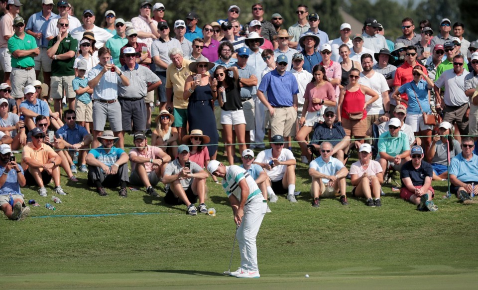 <strong>Jason Day makes a long putt on the ninth hole during the second round of tournament play at the WGC-FedEx St. Jude Invitational at TPC Southwind on July 26, 2019.</strong> (Jim Weber/Daily Memphian)