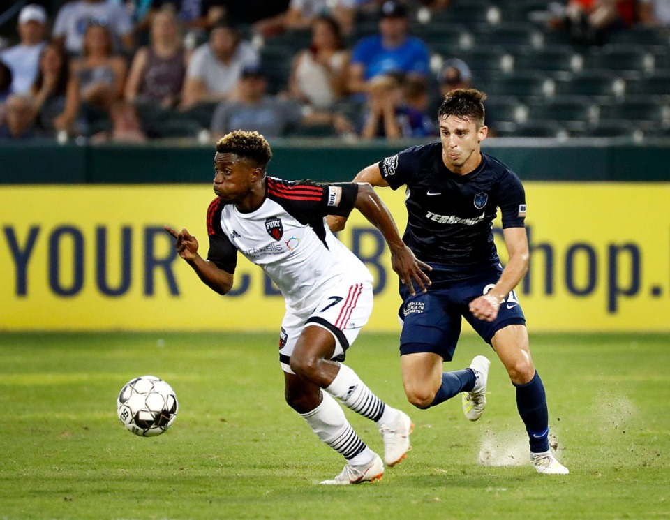 <strong>Memphis defender Wes Charpie (22) chases down an Ottawa Fire attacker&nbsp;during the 901 FC home victory on Saturday, July 27, 2019, at AutoZone Park. </strong>(Patrick Lantrip/Daily Memphian)