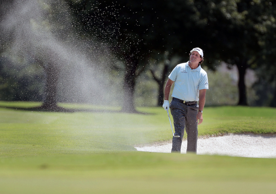 <strong>Phil Mickelson tries to blast a shot out of the bunker on the last day of the World Golf Championships in Memphis Sunday, July 28.</strong> (Patrick Lantrip/Daily Memphian)