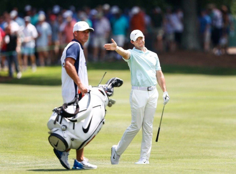 <strong>Rory McIlroy mimics the direction of his shot at the sixth hole Sunday.</strong> (Mark Weber/Daily Memphian).