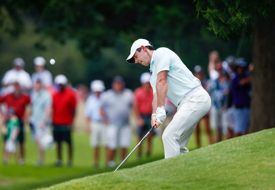 <strong>Rory McIlroy chips from the side of a hill onto the green Sunday.</strong>&nbsp;(Mark Weber/Daily Memphian).
