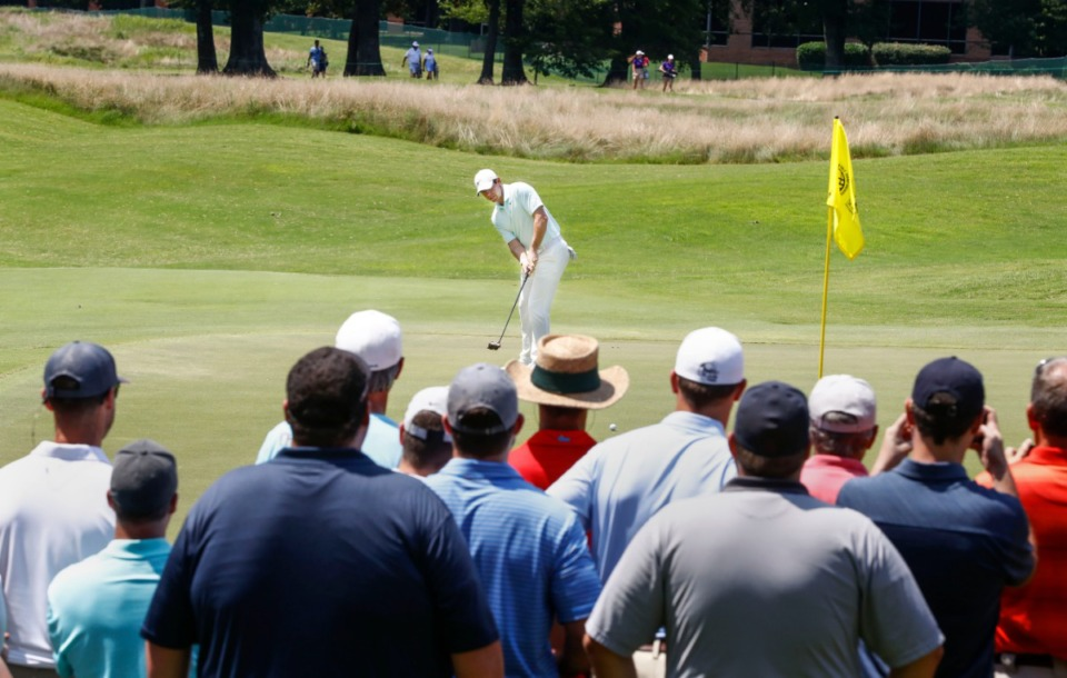 <strong>Record crowds surrounding the final twosome watch as Rory McIlroy putts on the seventh hole Sunday.&nbsp;</strong> (Mark Weber/Daily Memphian).