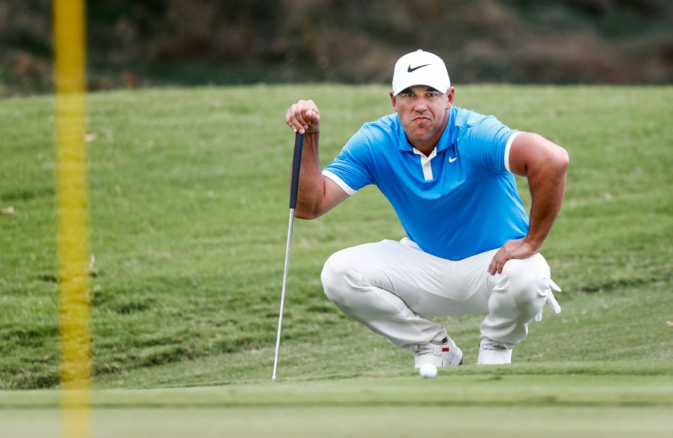 <strong>Brooks Koepka lines up a putt on the second hole during final round action Sunday.</strong> (Mark Weber/Daily Memphian).