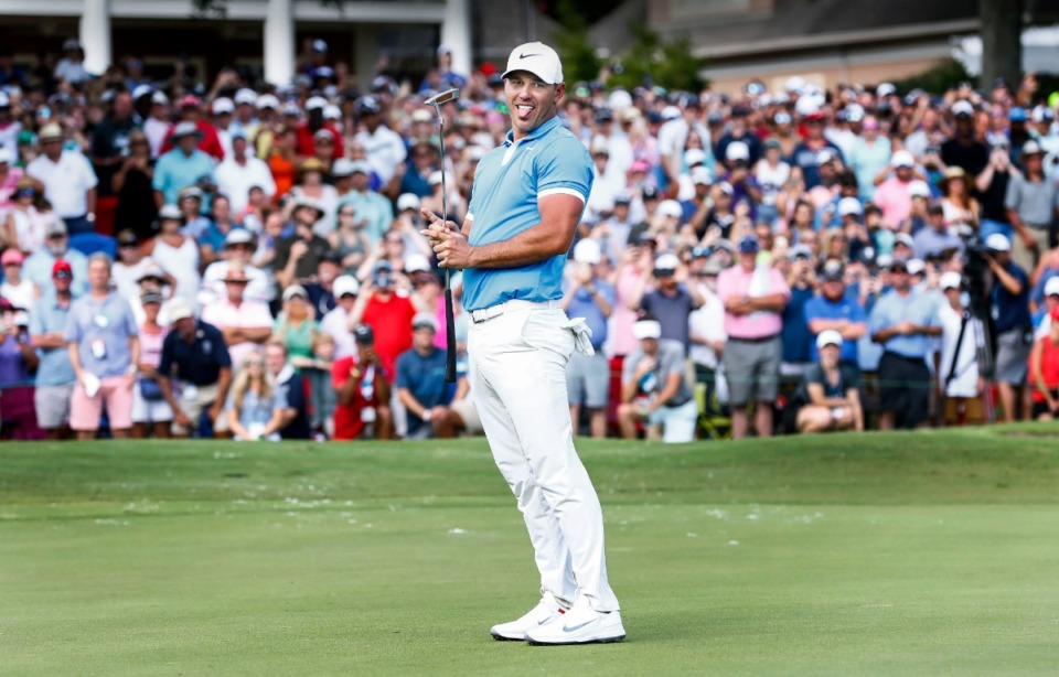 <strong>PGA golfer Brooks Koepka reacts after missing a birdie putt at hole 18, while on his way to winning the WGC-FedEx St. Jude Invitational at TPC Southwind, Sunday, July 28, 2019. Koepka, shot 16-under for the tournament and 5-under on the final day.</strong> (Mark Weber/Daily Memphian).