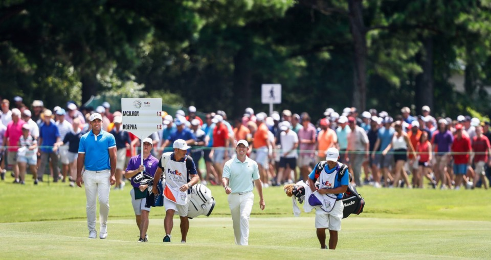 <strong>A large crowd follows PGA golfers Brooks Koepka (left) and Rory McIlroy (right) during final round action at the WGC-FedEx St. Jude Invitational at TPC Southwind, Sunday, July 28, 2019.</strong> (Mark Weber/Daily Memphian).