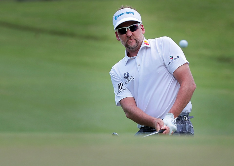 <strong>Ian Poulter chips a shot towards the green on the last day of the World Gold Championships in Memphis Sunday, July 28.</strong> (Patrick Lantrip/Daily Memphian)