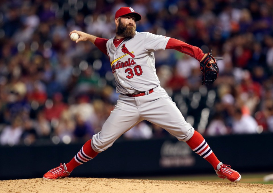 <strong>Former St. Louis Cardinals relief pitcher Jason Motte works against the Colorado Rockies to get the final out in the ninth inning of a baseball game in Denver on June 23, 2014.</strong> (AP Photo/David Zalubowski, File)