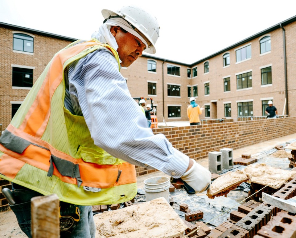 <strong>Alfredo Espino of Rebel Equipment and Supply employee lays bricks during construction of the Thornwood apartments in Germantown in September 2018. Germantown aldermen discussed the future of apartments in the suburb at a Monday work session following the expiration of an 18-month construction moratorium earlier this month.&nbsp;</strong>(Houston Cofield/Daily Memphian file)