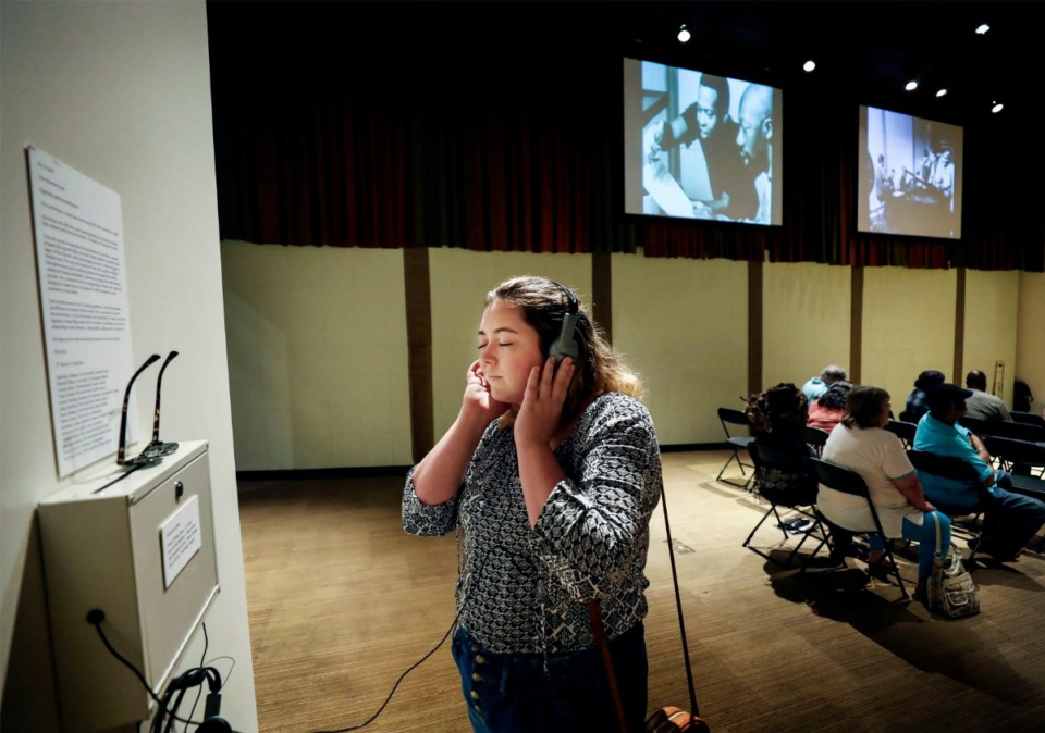 <strong>Madi Butler, 27, listens to music by Sam &amp; Dave while touring the Stax Museum of American Soul Music on Tuesday, July 30, 2019. Butler is on a 50-day train trip from Portland, Maine, to San Francisco as part of an internship called Summer By Rail.</strong> (Mark Weber/Daily Memphian)