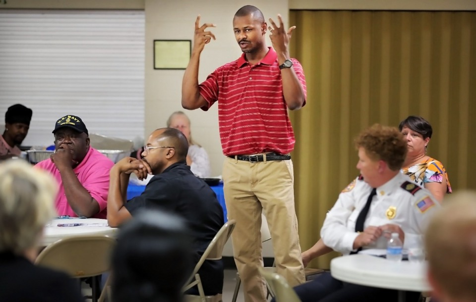 <strong>Pastor Charlie Caswell announces an upcoming training program to help kids suffering from childhood trauma during a weekly meeting of the Frayser Exchange Club at Impact Baptist Church on Thursday, Aug. 1, 2019. The Frayser Exchange Club, which consists of area business owners, organization leaders and active residents, is celebrating its 50th year.</strong> (Jim Weber/Daily Memphian)