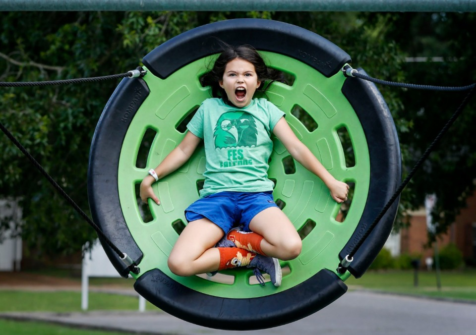 <strong>Lyla Brower, 11, a soon-to-be fifth-grader at Farmington Elementary School, screams while swinging high at Farmington Park Thursday, Aug. 1, 2019. The Germantown Parks Commission has approved new rules restricting public use of the parks during school hours.</strong>&nbsp;(Mark Weber/Daily Memphian)