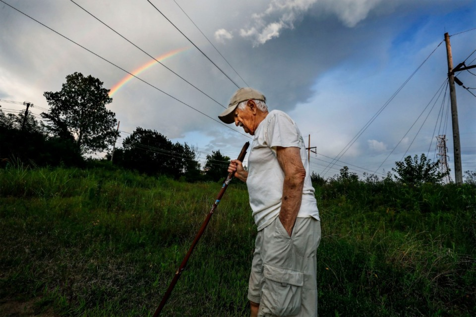 <strong>A rainbow appears in the evening sky as Nonconnah Creek Conservancy member Gene McKenzie hikes through Nash-Buckingham Park near Getwell Road on July 20, 2019.</strong> (Mark Weber/Daily Memphian)
