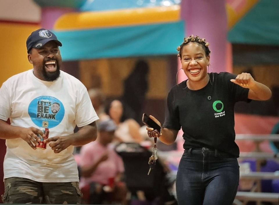 <strong>Memphis City Council candidate Frank Johnson (left) and Friends of the Earth volunteer Terri Conley dance to the music at a Friends of the Earth rally June 29, 2019. Johnson, who is running for Super District 8-2, is suggesting the city invest in home modernization projects for existing homeowners.&nbsp;</strong>(Jim Weber/Daily Memphian file)