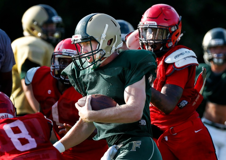 <strong>First Assembly Christian School quarterback Cole Putnam runs for a first down during a scrimmage game against Raleigh-Egypt on Aug. 1, 2019.</strong> (Mark Weber/Daily Memphian).