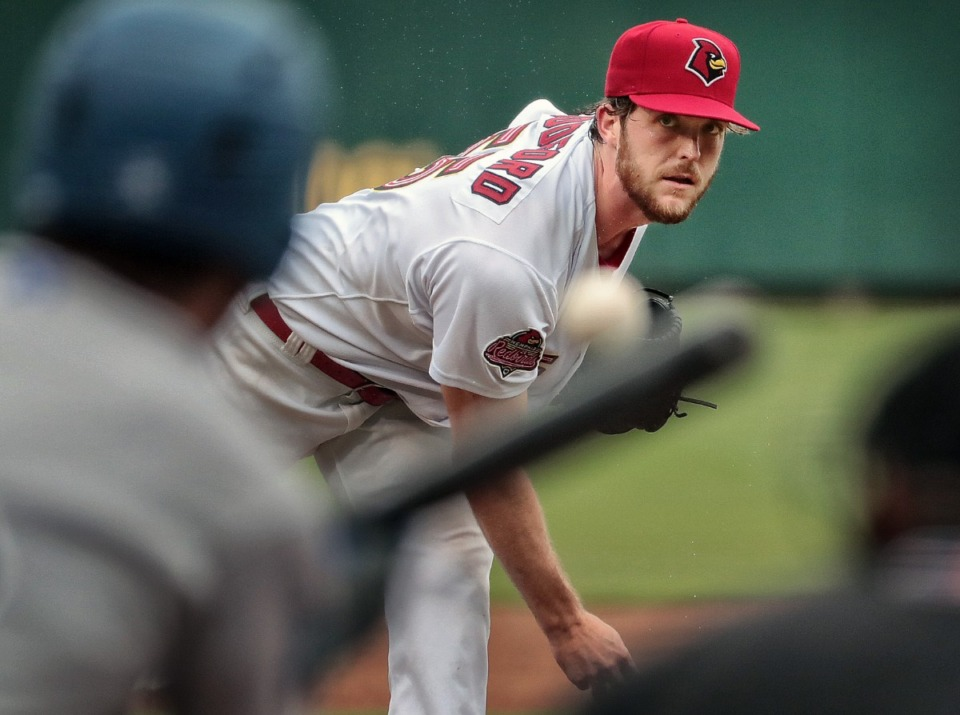 <strong>Jake Woodford pitches into a bunt during the a September 2018 Redbirds game against Oklahoma City at AutoZone Park.</strong> (Jim Weber/Daily Memphian)