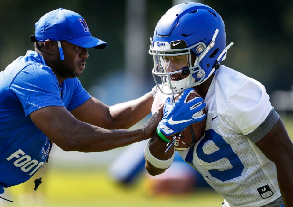 <strong>University of Memphis running back Kenneth Gainwell (right) goes through drills during practice on Friday, Aug. 2, 2019.</strong> (Mark Weber/Daily Memphian).