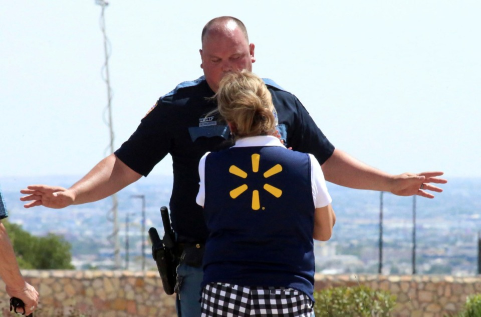 <strong>An El Paso police officer talks to a store employee following a shooting at a retail center in El Paso, Texas, on Saturday, Aug. 3, 2019. Multiple people were killed and one person was in custody after a shooter went on a rampage at a shopping mall, police in El Paso said.</strong> (AP Photo/Rudy Gutierrez)