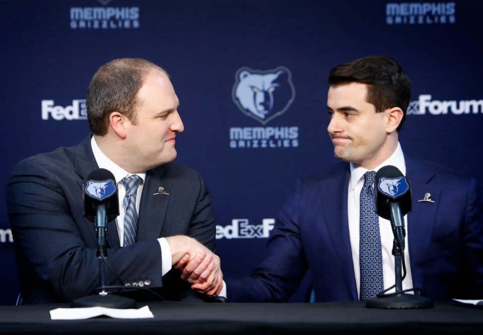 <strong>Taylor Jenkins (left) shakes hands with Memphis Grizzlies VP of Basketball Operations Zachary Kleiman after being named the team's new head coach during a press conference at FedExForum on June 12. On Monday, Aug. 5,</strong><span><strong>&nbsp;Jenkins announced his coaching staff.</strong>&nbsp;</span>(Mark Weber/Daily Memphian file)