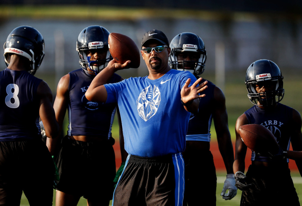 <strong>Kirby High School head coach Chester Flowers runs his players through drills during practice Monday, August 5, 2019.</strong> (Mark Weber/Daily Memphian).