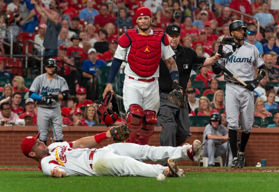 <strong>St. Louis Cardinals catcher Yadier Molina (center), looks at teammate Paul Goldschmidt after he missed a pop fly in a baseball game against the Miami Marlins on June 18, 2019, in St. Louis.</strong> (AP Photo/L.G. Patterson)