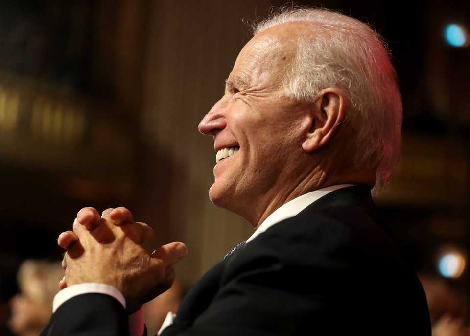 <strong>Former vice president Joe Biden laughs as Rev. Jesse Jackson makes a joke on stage at the 2018 Freedom Awards. Biden recounted some of the greatest victories in the civil rights movement but made it clear he believes civil rights are strongly threatened under the current White House administration.&nbsp;</strong>(Houston Cofield/Daily Memphian)