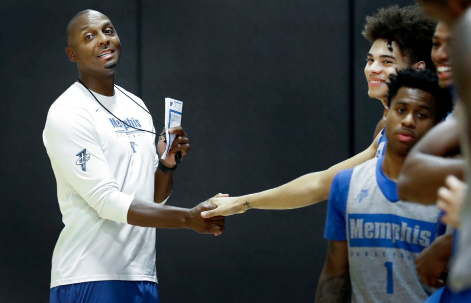 <strong>University of Memphis head basketball coach Penny Hardaway greets player Lester Quinones (right) before practice Tuesday, August 6.</strong> (Mark Weber/Daily Memphian)