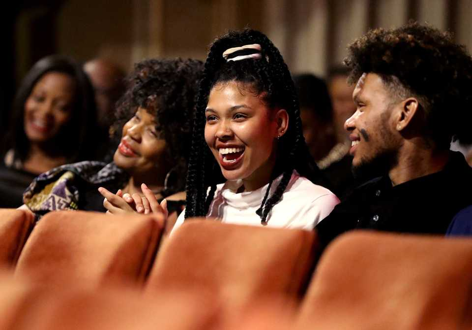 <strong>Victorie Franklin (center) and Jordan Franklin (right), the grandchildren of Aretha Franklin, laugh as Rev. Jesse Jackson makes a joke on stage at the 2018 Freedom Awards.&nbsp;</strong>(Houston Cofield/Daily Memphian)