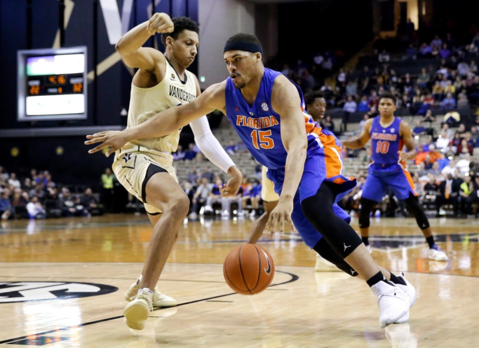 <strong>Florida forward Isaiah Stokes (15) drives against Vanderbilt forward Matthew Moyer in the first half of an NCAA college basketball game Feb. 27, 2019.</strong> (AP Photo/Mark Humphrey)