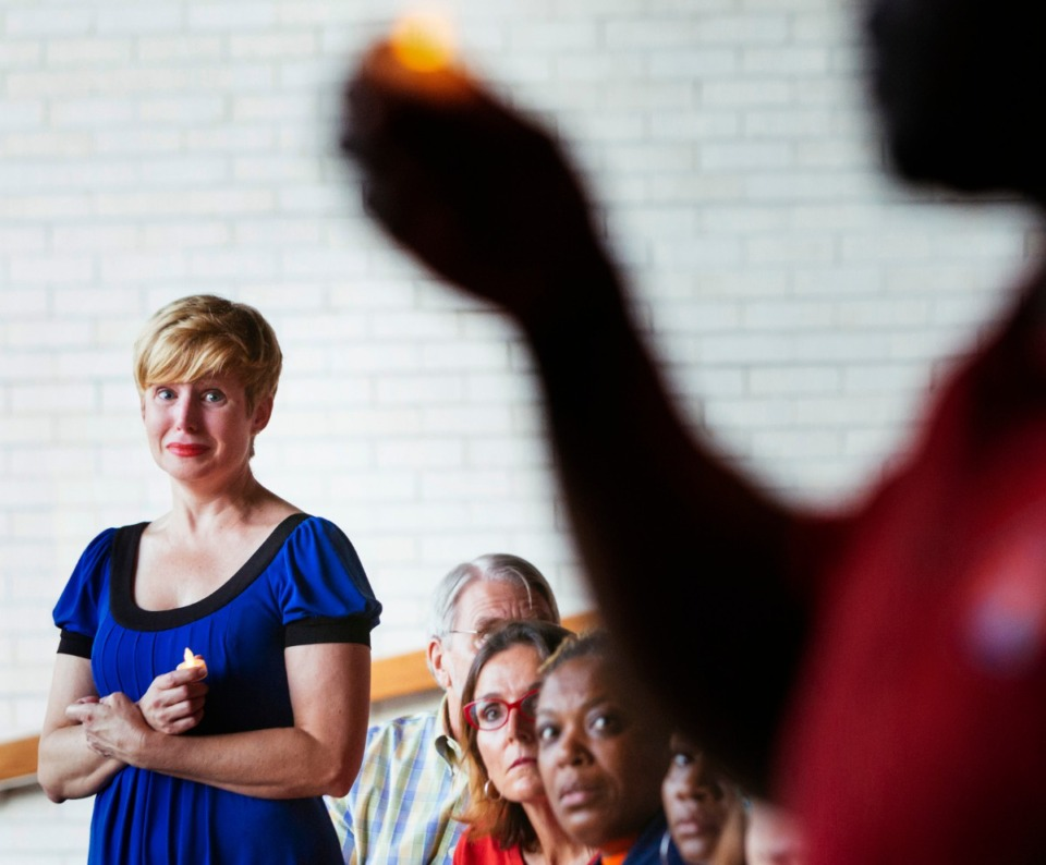 "<p class=""p1""><strong><span class=""s1"">Courtney Staub joins those gathered on Wednesday, Aug. 7, 2019, at Church of the River in Memphis for a vigil honoring victims of gun </span><span class=""s2"">violence. During the event, organized by Memphis Moms Demand Action, speakers recited </span><span class=""s1"">the names of victims in the recent mass shootings </span><span class=""s2"">in El Paso, Texas, and Dayton, Ohio, as well as the names of those shot and killed in the Mid-South this year and</span></strong><span class=""s1""><strong> victims of gun violence whom they knew personally. </strong>(Ziggy Mack/Special to the Daily Memphian)</span>"