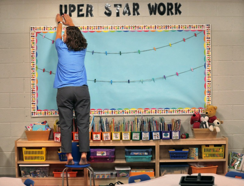 <strong>Kindergarten teacher Lori Matthews decorates her classroom as teachers, administrators and construction crews put the finishing touches on Germantown's new Forest Hill Elementary on Aug. 8, 2019.&nbsp;The school will welcome its first class of students next week.&nbsp;</strong>(Jim Weber/Daily Memphian)