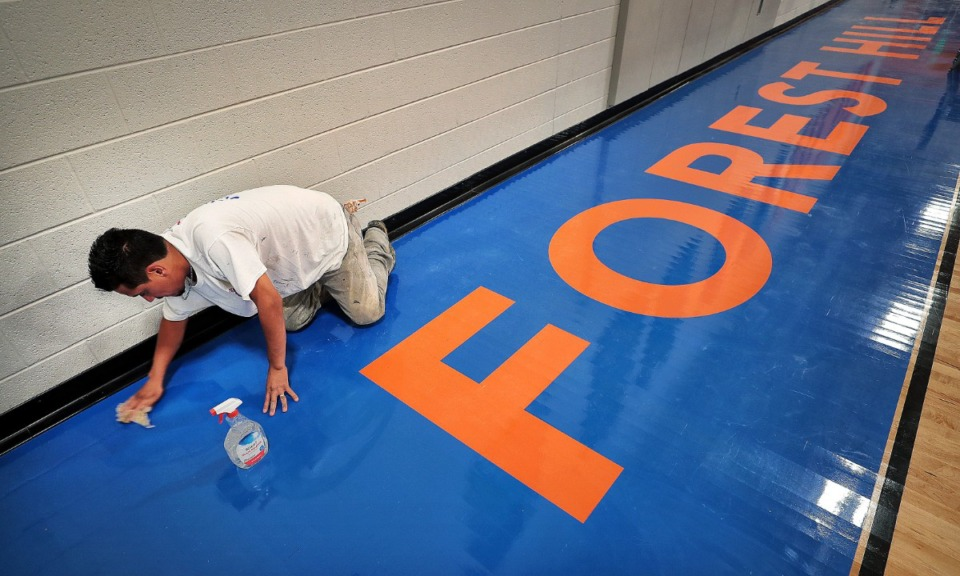 <strong>Kevin Flores cleans up in the gymnasium as the finishing touches are being put on Germantown's new Forest Hill Elementary on Aug. 8, 2019.</strong>&nbsp;(Jim Weber/Daily Memphian)