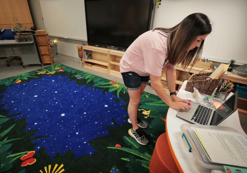 <strong>Kindergarten teacher Andrea Dancy gets her classroom ready as teachers, administrators and construction crews put the finishing touches on Germantown's new Forest Hill Elementary on Aug. 8, 2019.</strong>&nbsp;(Jim Weber/Daily Memphian)