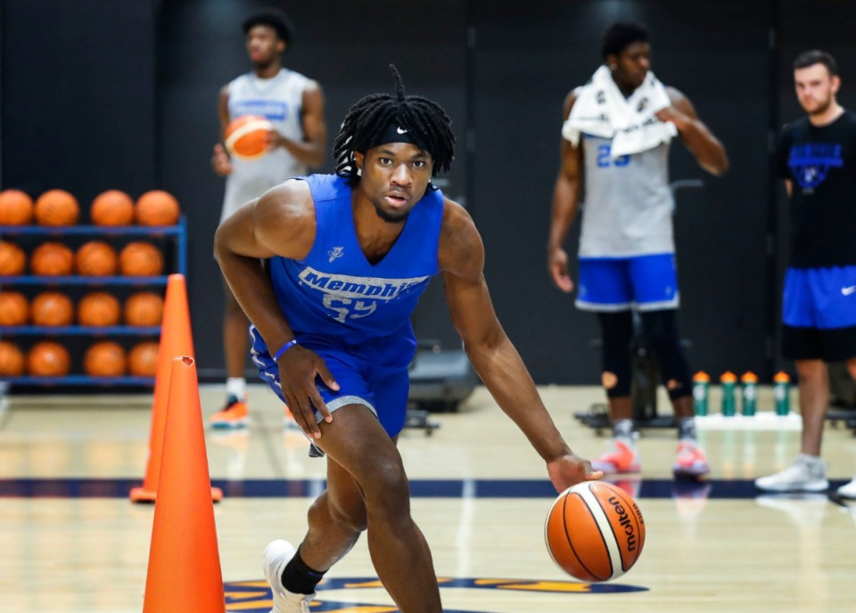 <strong>University of Memphis forward Precious Achiuwa works on his dribbling skills during practice Tuesday, Aug. 6. Achiuwa moved from Nigeria to the U.S. at age 13 to pursue better educational opportunities, but eventually followed the footsteps of his brother &ndash; who played for St. John&rsquo;s &ndash; and developed into a hoops prospect.</strong> (Mark Weber/Daily Memphian)