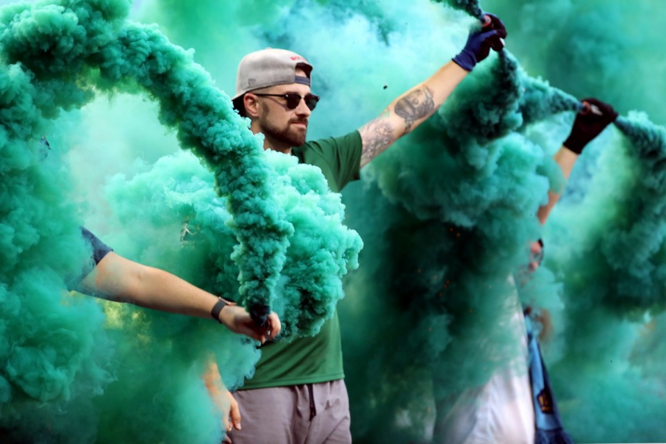 <strong>Multicolored smoke fills the air before every Memphis 901 FC home game, thanks to an extremely loyal group of fans known as the Bluff City Mafia. The supporters group hypes the crowd before a July 17 match against Nashville at AutoZone Park.</strong> (Patrick Lantrip/Daily Memphian)