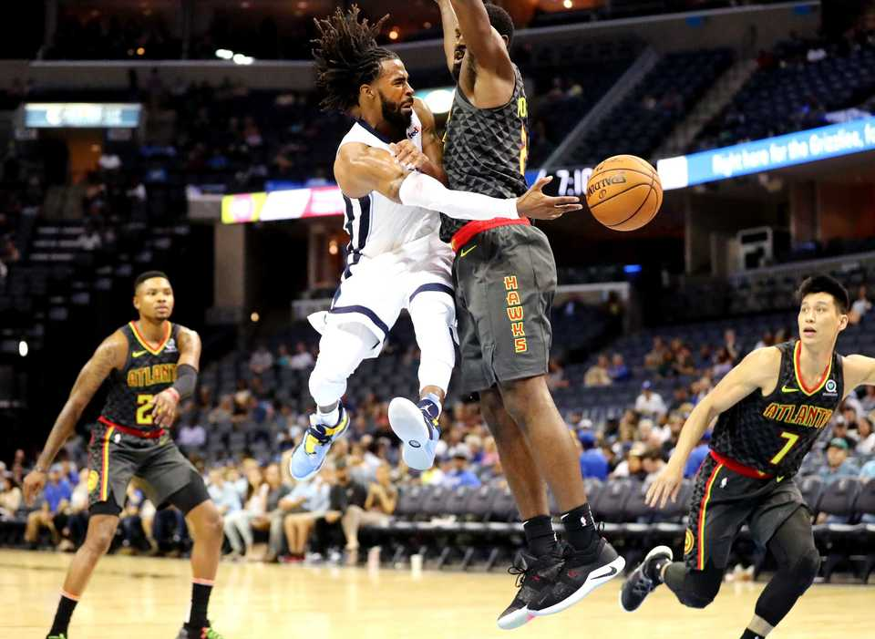 <strong>Grizzlies guard Mike Conley passes to a teammate under the goal during a game against the Atlanta Hawks. The Grizzlies beat the Hawks 110-120 in the first preseason game of the year.</strong> (Houston Cofield/Daily Memphian)