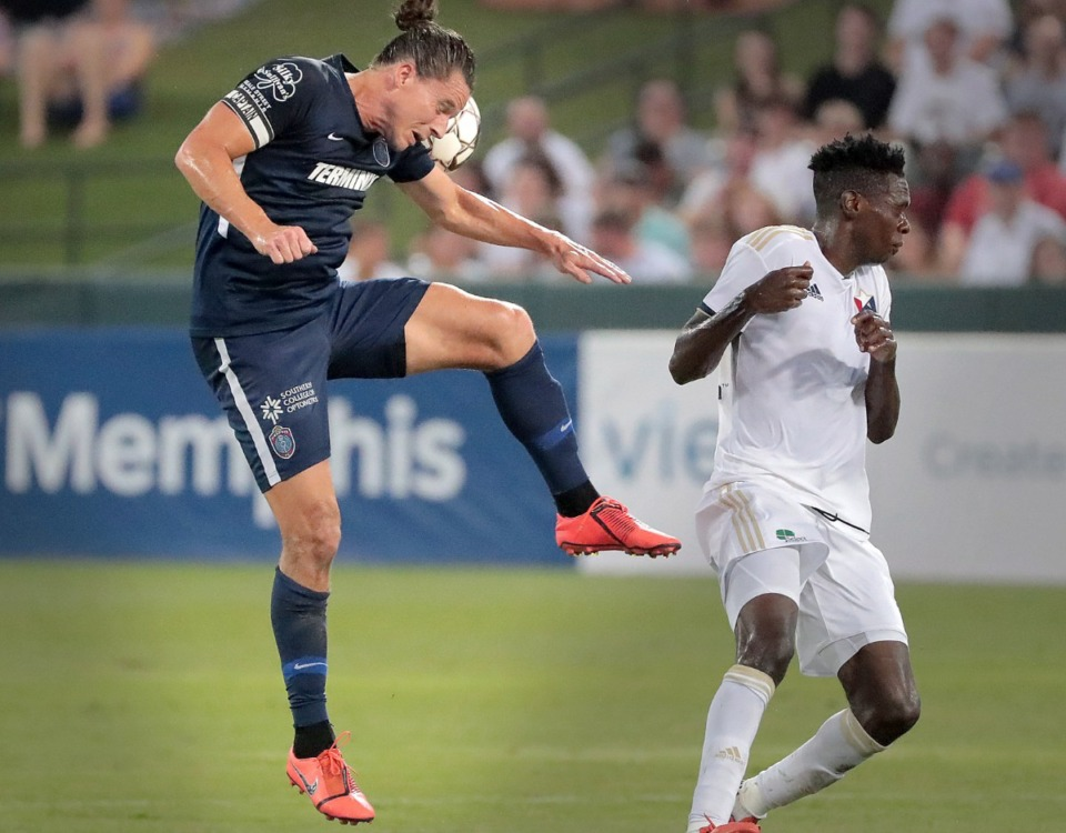 <strong>Memphis defender Marc Burch wins a header during 901FC's 2-1 loss to North Carolina FC at AutoZone Park on Aug. 10, 2019.</strong> (Jim Weber/Daily Memphian)
