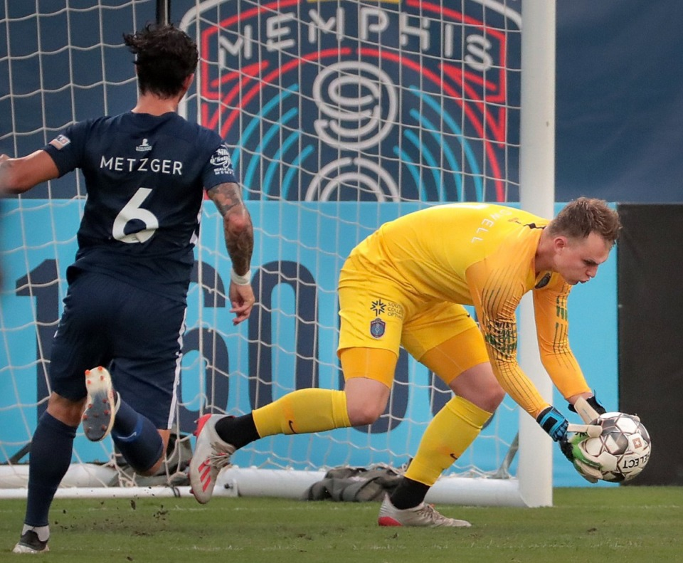 <strong>Memphis goalie Jeff Caldwell scoops up a shot attempt during 901FC's 2-1 loss to North Carolina FC at AutoZone Park on Aug. 10, 2019.</strong> (Jim Weber/Daily Memphian)