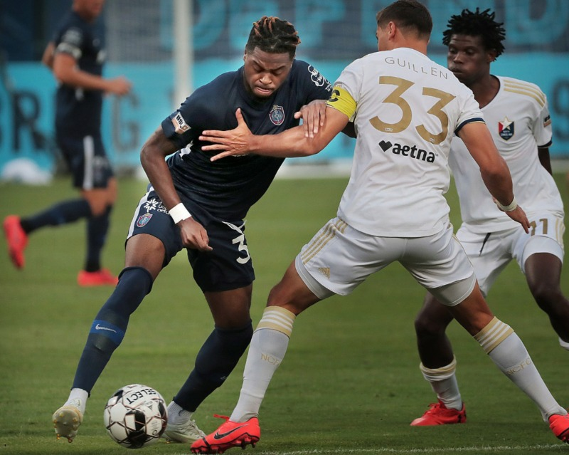 <strong>Memphis midfielder Marcus Epps (left) tries to get past North Carolina's Aaron Guillen (33) during 901FC's 2-1 loss to North Carolina FC at AutoZone Park on Aug. 10, 2019.</strong> (Jim Weber/Daily Memphian)