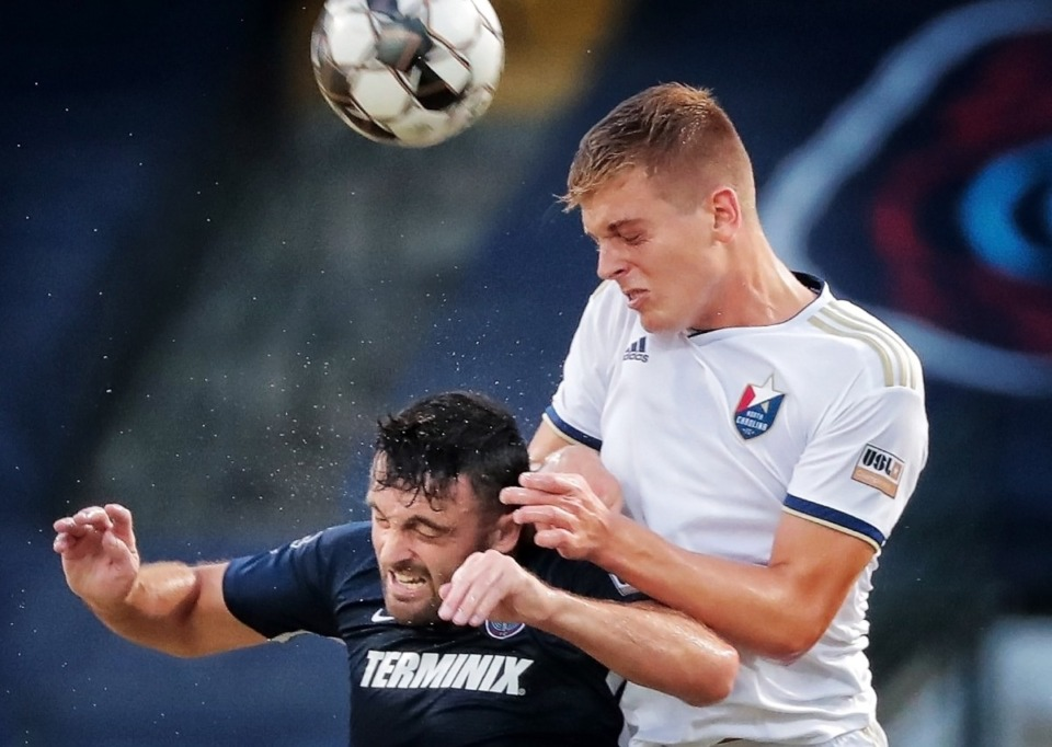 <strong>North Carolina's Sam Brotherton beats Memphis forward Brandon Allen (left) to the ball during 901FC's 2-1 loss to North Carolina FC at AutoZone Park on Aug. 10, 2019.</strong> (Jim Weber/Daily Memphian)