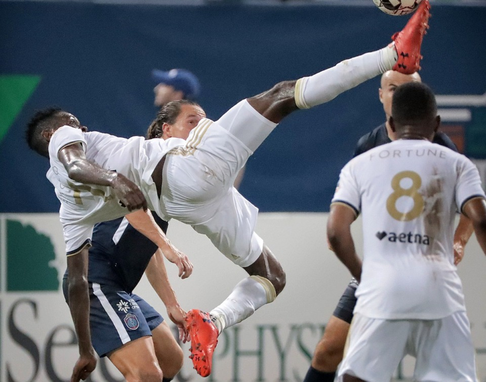 <strong>North Carolina's Donovan Ewolo attempts a bicycle kick during 901FC's 2-1 loss to North Carolina FC at AutoZone Park on Aug. 10, 2019.</strong> (Jim Weber/Daily Memphian)