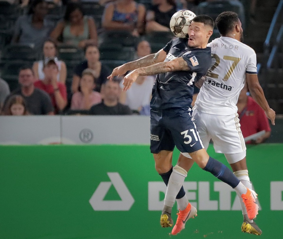 <strong>Memphis midfielder Pierre Da Silva (31) battles for a header with North Carolina's DJ Taylor (27) during 901FC's 2-1 loss to North Carolina FC at AutoZone Park on Aug. 10, 2019.</strong> (Jim Weber/Daily Memphian)