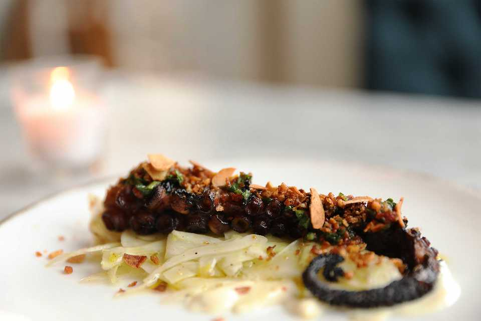 <strong>The octopus is freshly harvested, poached in soda water and olive oil, marinated then grilled. It's served with&nbsp;shaved fennel, bits of fried sunchoke, aioli and sun-dried tomato and pepper.</strong>&nbsp;(Patrick Lantrip/Daily Memphian)
