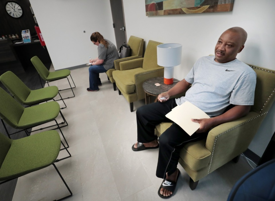 <strong>Cedric Thomason with the Shelby County Sheriff's Department waits for a wellness exam on Aug. 9, at a new free health clinic for Shelby County employees that has recently opened on Poplar Avenue. The clinic is meant to provide wellness exams and treat non-emergency patients who work for the county.</strong> (Jim Weber/Daily Memphian)