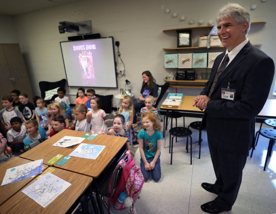 <strong>Collierville schools superintendent Gary Lilly laughs with Mrs. Kelley's second-graders at Tara Oaks Elementary during the first day of school Monday, Aug. 12.</strong> (Patrick Lantrip/Daily Memphian)