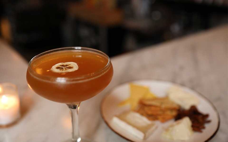 <strong>Drinks at Andrew Michael Italian Kitchen are named for departed Memphis restaurants. The 91st Bomb Group has Smith &amp; Cross rum, creme de banane, cachaca, sfumato, lime, honey and sparkling wine.</strong> (Patrick Lantrip/Daily Memphian)