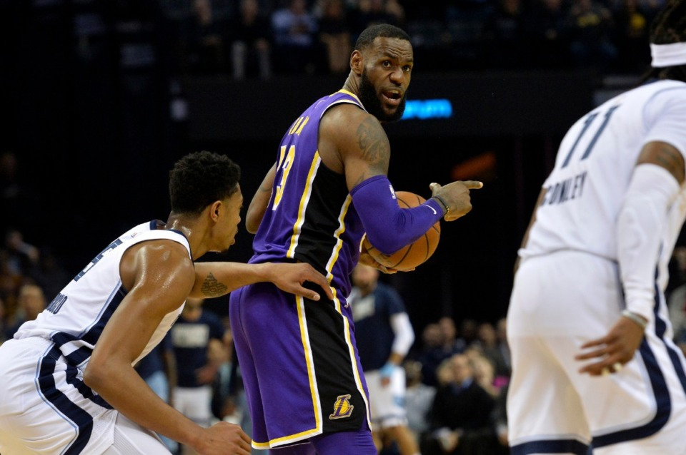<strong>Los Angeles Lakers forward LeBron James, center, calls to teammates against Grizzlies forward Bruno Caboclo, left, in the first half of an NBA basketball game Monday, Feb. 25, 2019, in Memphis.&nbsp;</strong>(AP Photo/Brandon Dill)