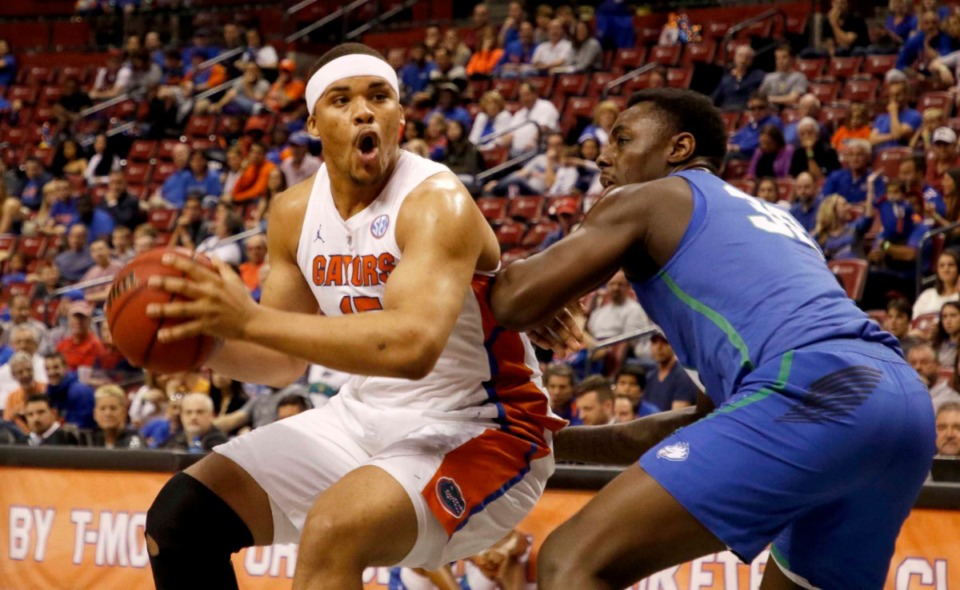<strong>Florida forward Isaiah Stokes (left) looks to the basket as Florida Gulf Coast forward Brian Thomas (30) defends in the first half of an NCAA college basketball game, part of the Orange Bowl Classic tournament on Dec. 22, 2018, in Sunrise, Fla.</strong> (AP Photo/Joe Skipper)
