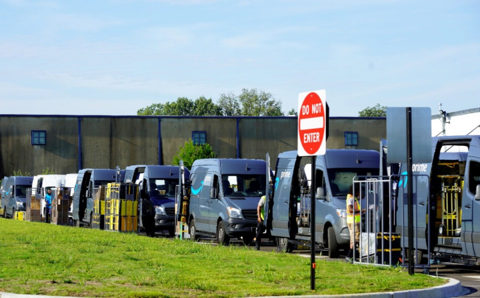 <strong>Delivery vans that fill a parking lot line up to be filled with packages at Amazon's new delivery-station warehouse at 3347 Pearson in Southeast Memphis.</strong> (Tom Bailey/The Daily Memphian)
